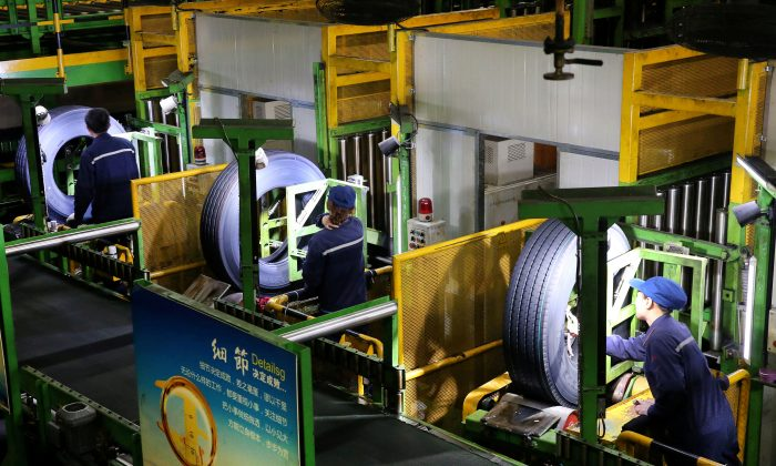 Workers are seen at a production line manufacturing tires at a factory in Nantong, Jiangsu Province, China on April 28, 2019. (Reuters)