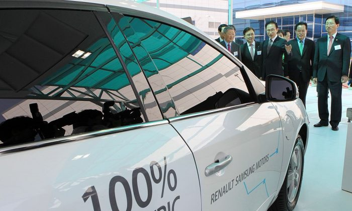 Former South Korean President Lee Myung-Bak (C) looks at an electric car during a dedication ceremony for LG Chem's car battery plant at the town of Ochang, South Korea, on April 6, 2011. (Dong-A Ilbo/AFP/Getty Images)