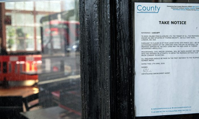 A repossession notice in a file photo. (Jack Taylor/Getty Images)