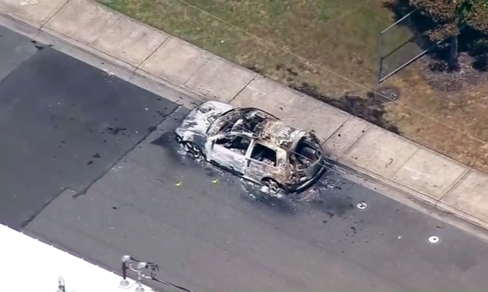 Aerial footage shows a car destroyed by Antifa extremist Willem Van Spronsen on July 13. (Screenshot/Reuters)