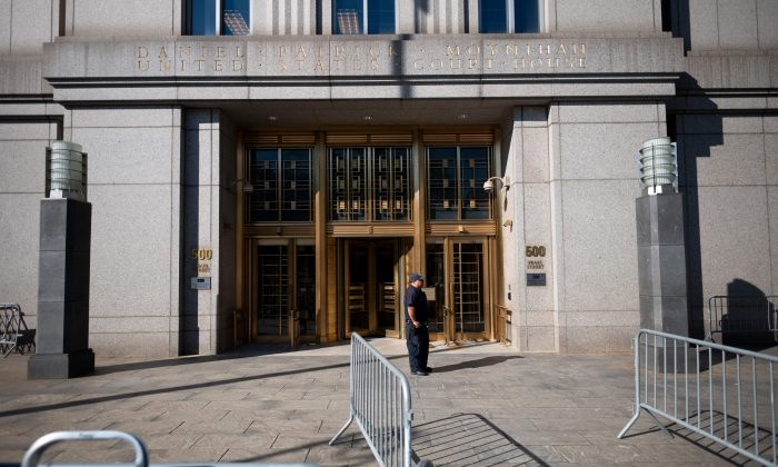 A policeman stands at the courthouse ahead of a bail hearing in U.S. financier Jeffrey Epstein's sex trafficking case in New York City on July 15, 2019. (JOHANNES EISELE/AFP/Getty Images)