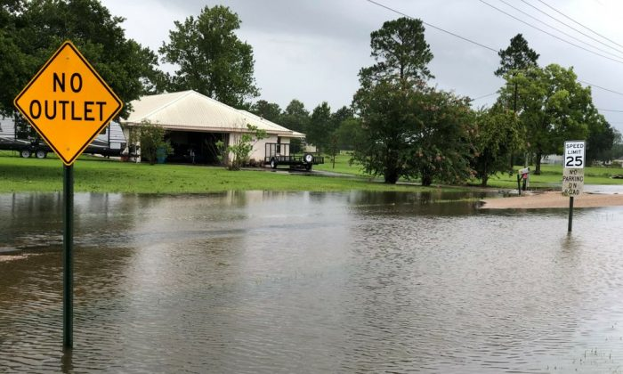 Floodwater pools near homes in St. Martinville, La., in the aftermath of Tropical Storm Barry, on July 14, 2019, (Carrie Cuchens via AP)