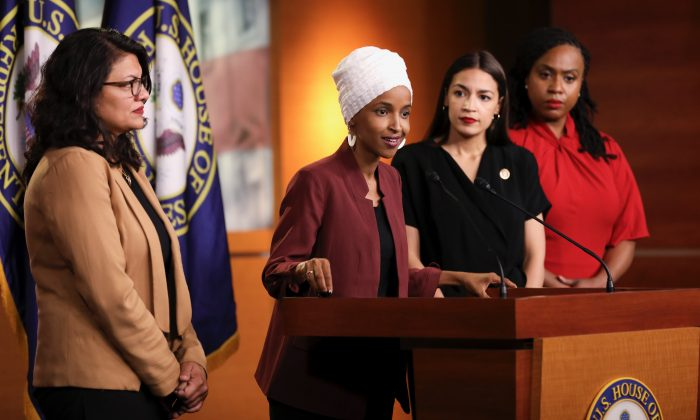 Reps. Alexandria Ocasio-Cortez (D-N.Y.), Ilhan Omar (D-Minn.), Ayanna Pressley (D-Mass.), and Rashida Tlaib (D-Mich.) speak at a press conference at the U.S. Capitol on July 15, 2019. (Holly Kellum/NTD)
