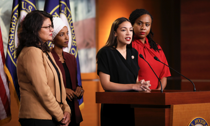 Reps. Rashida Tlaib (D-Mich.), Ilhan Omar (D-Minn.), Alexandria Ocasio-Cortez (D-N.Y.), and Ayanna Pressley (D-Mass.) speak at a press conference at the Capitol on July 15, 2019. (Holly Kellum/NTD)
