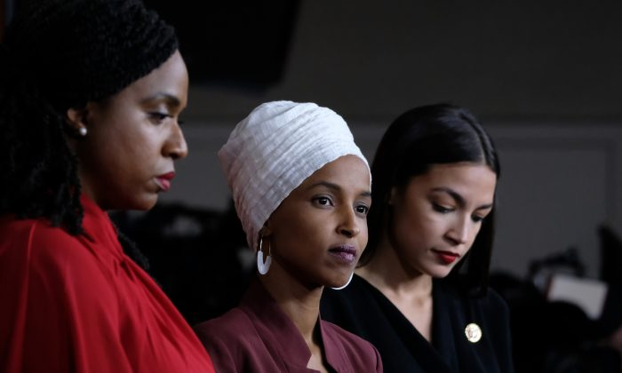 Reps. Ayanna Pressley (D-Mass.), Ilhan Omar (D-Minn.) and Alexandria Ocasio-Cortez (D-N.Y.) listen during a news conference at the U.S. Capitol on July 15, 2019. (Alex Wroblewski/Getty Images)