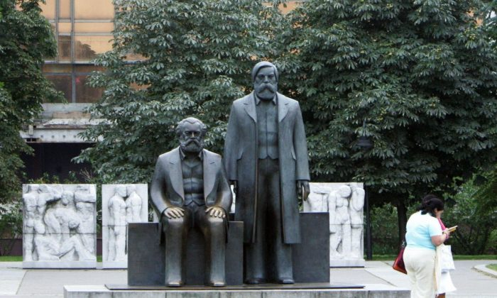 A statue of Karl Marx and Friedrich Engels, the main architects of communism, in front of the Palace of the Republic in Berlin, Germany. (John MacDougall/AFP/Getty Images)