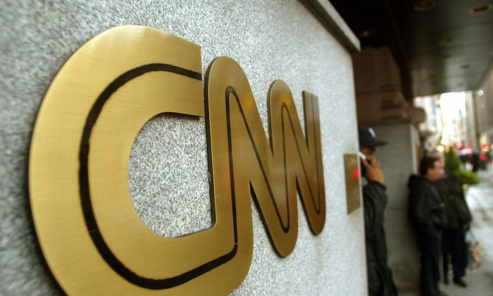 The CNN sign is seen outside its headquarters in New York City, N.Y., on Nov. 12, 2002. (Mario Tama/Getty Images)