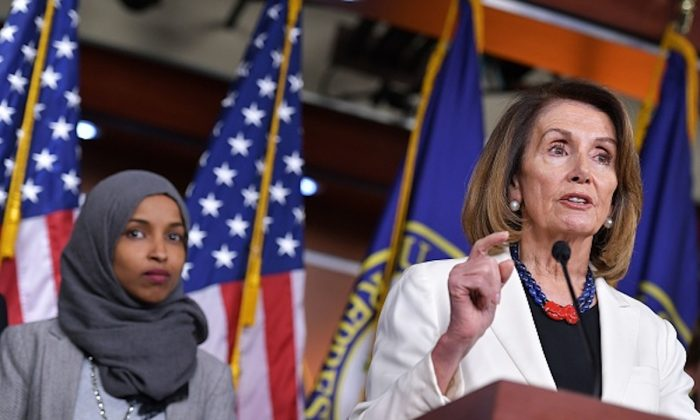 House Minority Leader Nancy Pelosi speaks during a press conference in the House Visitors Center at the US Capitol in Washington, DC on Nov. 30, 2018.  At left is representative-elect Ilhan Omar, D-MN. (MANDEL NGAN / AFP)