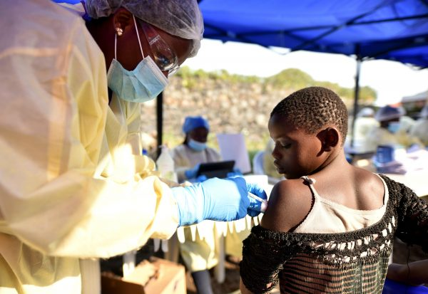 A Congolese health worker administers ebola vaccine to a child at the Himbi Health Centre in Goma, Democratic Republic of Congo, July 17, 2019. (Olivia Acland/Reuters)