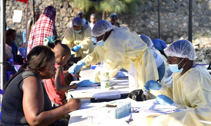 Congolese health workers collect data before administering ebola vaccines to civilians at the Himbi Health Centre in Goma, Democratic Republic of Congo, July 17, 2019. (Olivia Acland/Reuters)
