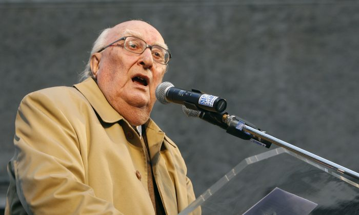 Italian author Andrea Camilleri makes his point during a demonstration against the Vatican's influence on the ongoing right-to-die debate, in Rome on Feb. 21, 2009. (Alessandra Tarantino/File Photo via AP)