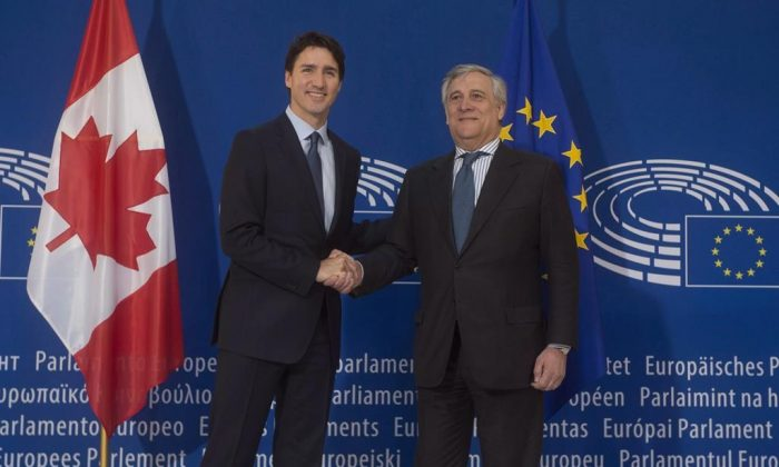 Canadian Prime Minister Justin Trudeau is greeted by the President of the European Parliament, Antonio Tajani as he arrives at the European Parliament in Strasbourg, France on February 16, 2017. (Adrian Wyld/The Canadian Press)
