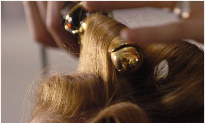 Hair being curled for a New York fashion show in a file photo. (Stan Honda/AFP/Getty Images)