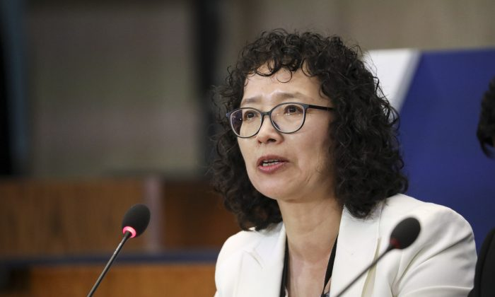 Yuhua Zhang, a Falun Gong practitioner who survived persecution in China, speaks at the Ministerial to Advance Religious Freedom at the Department of State in Washington on July 17, 2019. (Samira Bouaou/The Epoch Times)