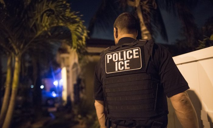 An Immigration and Customs Enforcement agent takes part in an operation on March 21, 2018. (ICE)