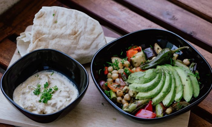 File photo showing a bowl of hummus and other food items. (Kevin McCutcheon/Unsplash)