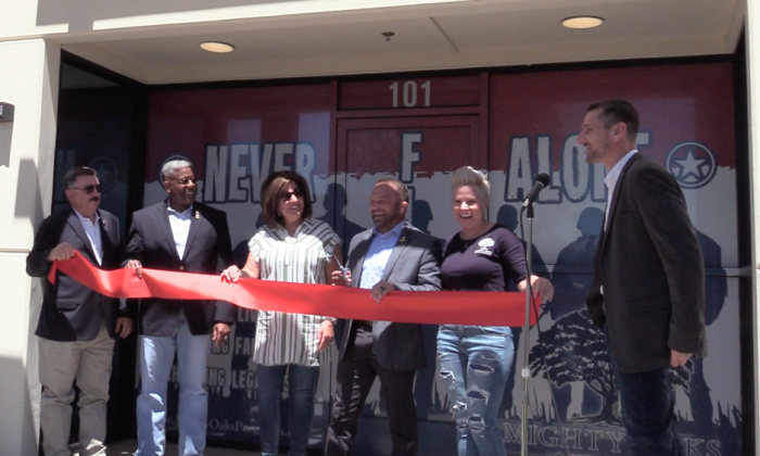 Mighty Oaks ribbon cutting ceremony for its new office opening in Murrieta, Calif. on May 9, 2019. Former US Congressman Allen West (2nd from the left), MOF founder Chad Robinchaux (4th from the left), Co-founder Kathy Robinchaux (5th from the left), and Jeremy (Courtesy of Mighty Oaks Foundation)