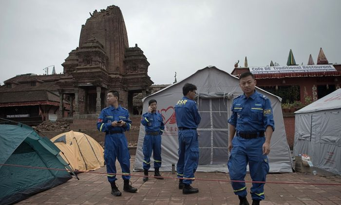 A Chinese rescue team stands outside their camp at the UNESCO world heritage site of Bhaktapur on the outskirts of the Nepalese capital Kathmandu on April 30, 2015. (Nicolas Asfouri/AFP/Getty Images)