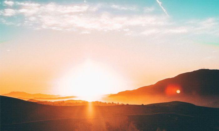 Stock photo showing the sun on the horizon. (Jordan Wozniak / Unsplash)