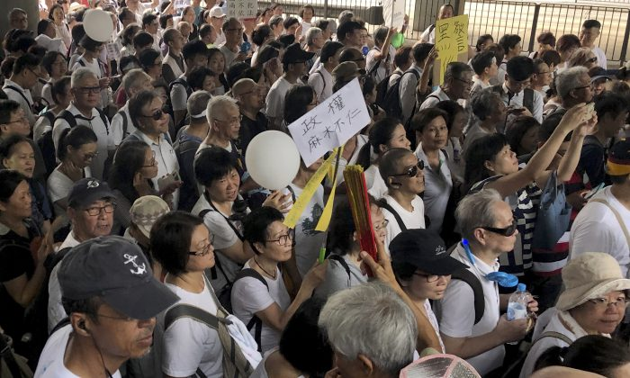 Elderly Hong Kong residents march in Hong Kong on July 17, 2019. Thousands of Hong Kong senior citizens, including a popular actress, marched in a show of support for youths at the forefront of month-long protests against a contentious extradition bill in the semi-autonomous Chinese territory. (Phoebe Lai/AP)