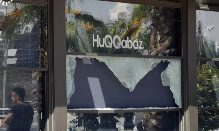 An Irbil-based Kurdish broadcaster, shows  broken glass shows in the window of a restaurant that was the scene of a shooting, in Irbil, Iraq, on July 17, 2019. (RUudaw Facebook TV via AP)
