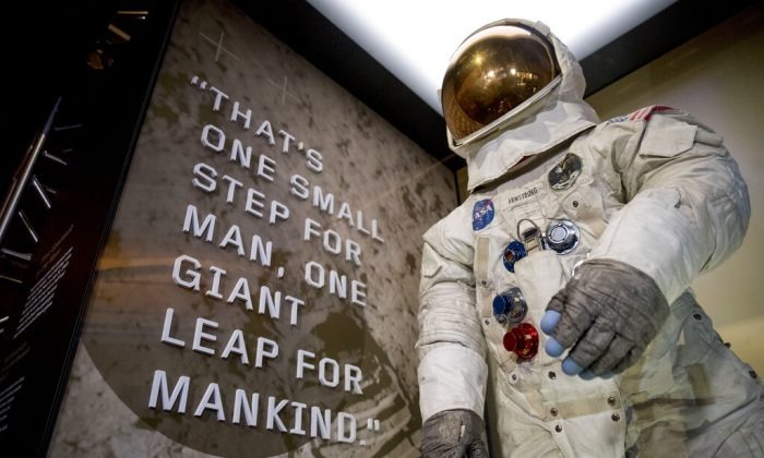 Neil Armstrong's Apollo 11 spacesuit is unveiled at the Smithsonian's National Air and Space Museum on the National Mall in Washington, on July 16, 2019. (Andrew Harnik/AP Photo)