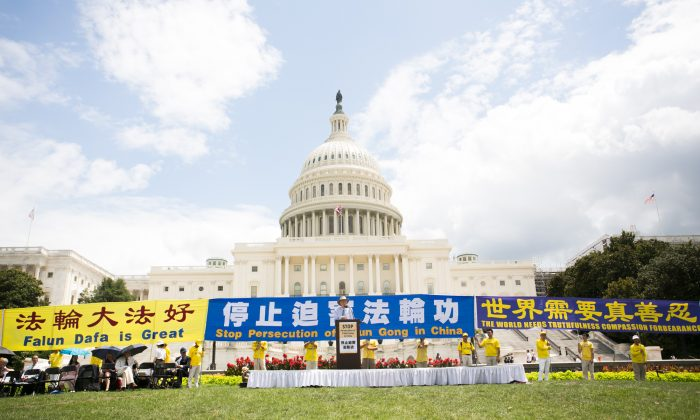 Falun Gong practitioners gathered for a rally on the anniversary of the Chinese regime's persecution of the spiritual discipline in Washington, on July 18, 2019. (Li Sha/The Epoch Times)
