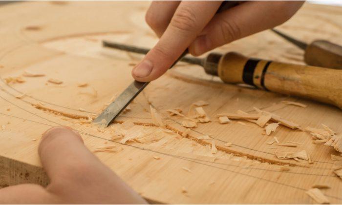 Stock photo of a carpenter at work. (Dominik Scythe / Unsplash)