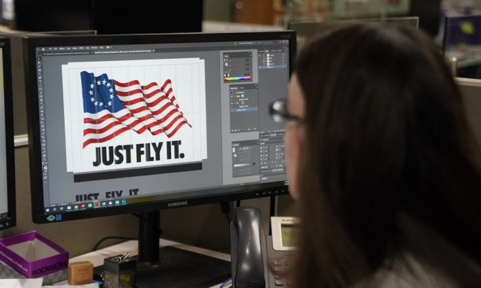 A worker designs a Just Fly It t-shirt with the Betsy Ross flag at Colonial Flag on July 5, 2019 in Salt Lake City, Utah.  George Frey/Getty Images