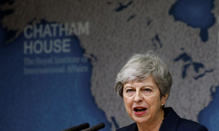 Britain's outgoing Prime Minister Theresa May delivers a speech at Chatham House in London on July 17, 2019. (HENRY NICHOLLS/AFP/Getty Images)