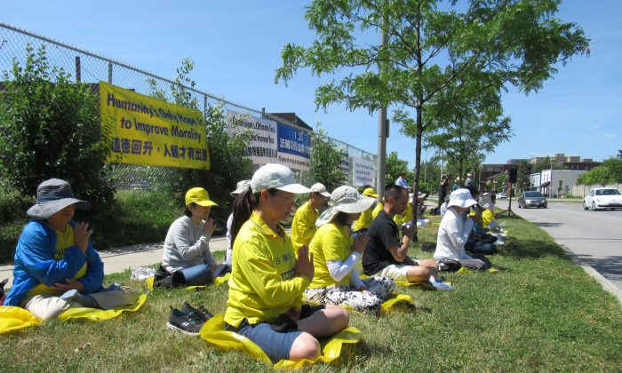 Falun Gong practitioners gather to peacefully demonstrate in front of the Chinese Embassy in Ottawa on July 20, 2019. The event marked 20 years of persecution by the Chinese Communist Party, and speakers urged the Canadian government to call on the regime to end its brutal campaign. (Donna He/The Epoch Times)