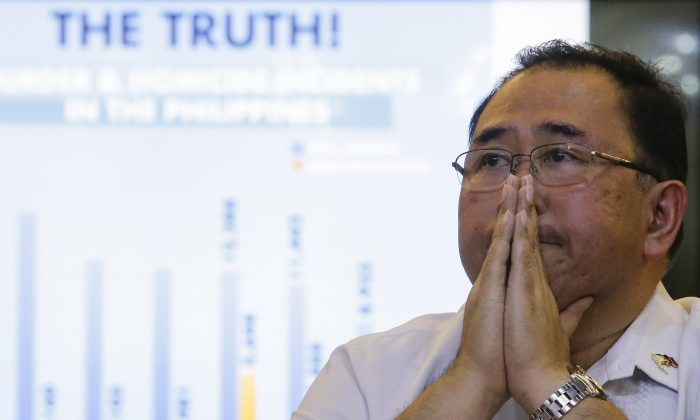 Undersecretary Severo Catura, executive director of the Presidential Human Rights Committee secretariat, gestures as he listens to questions from reporters during a news conference in metropolitan Manila, Philippines, on July 18, 2019. (Aaron Favila/AP Photo)