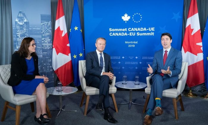 European Commissioner for Trade Cecilia Malmstrom and President of the European Council Donald Tusk listen to Prime Minister Justin Trudeau deliver remarks prior to a meeting in Montreal on July 18, 2019. (Paul Chiasson/The Canadian Press)