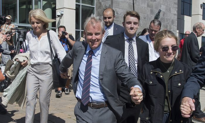Dennis Oland and family members head from the Law Courts in Saint John, N.B., after he was found not guilty of murdering his father on Friday, July 19, 2019. Justice Terrence Morrison of the New Brunswick Court of Queen's Bench found Oland not guilty of second degree murder. Richard Oland was beaten to death on July 6, 2011. (Andrew Vaughan/The Canadian Press)
