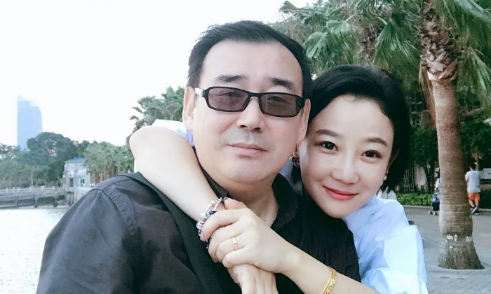 In this 2017 photo provided by his family, Yang Hengjun (L), poses with his family member in Beijing. (Yang Family Photo via AP)