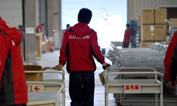 File photo of an employee working at Chinese online retailer JD.com (WANG ZHAO/AFP/Getty Images)