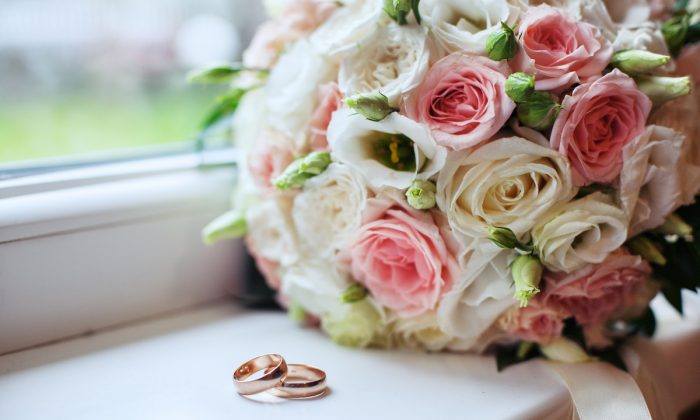 Wedding bouquet and rings. The concept of marriage and love. (Shutterstock)