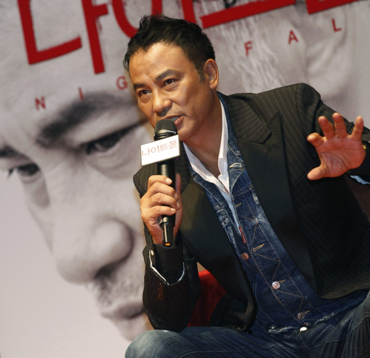 "Hong Kong actor Simon Yam speaks during a news conference to promote his movie ""Nightfall"" in Seoul"