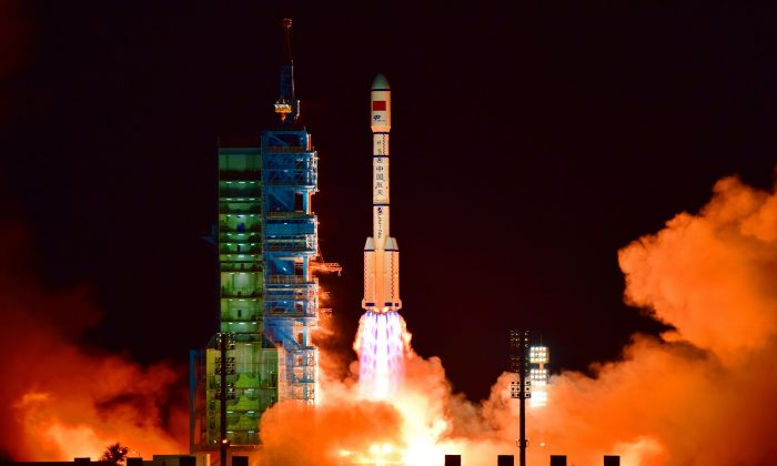 China's Tiangong 2 space lab is launched on a Long March-2F rocket from the Jiuquan Satellite Launch Center in the Gobi Desert, in China's Gansu province, on September 15, 2016. The space lab fell to Earth on July 19, 2019.  9-/AFP/Getty Images)