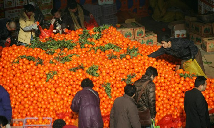 People shop at a market in Xian of Shaanxi Province, China, on Jan. 22, 2009. (China Photos/Getty Images)