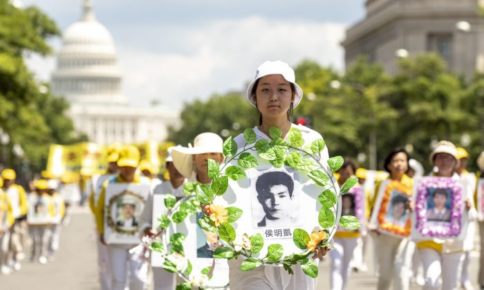 Falun Gong practitioners march from the U.S. Capitol to the Washington Monument commemorating the 20th anniversary of the persecution of Falun Gong in China, in Washington on July 18, 2019. (Samira Bouaou/The Epoch Times)
