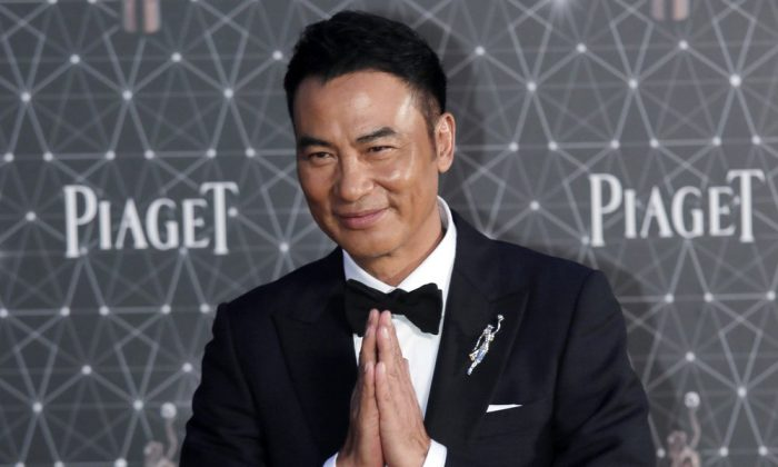 Hong Kong actor Simon Yam poses on the red carpet of the Hong Kong Film Awards in Hong Kong, on April 3, 2016. (AP Photo/Vincent Yu, File)