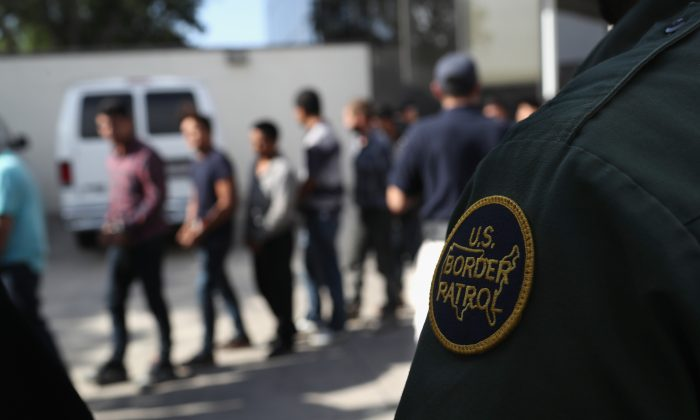 Illegal immigrants leave a U.S. federal court in shackles in McAllen, Texas on June 11, 2018. (John Moore/Getty Images)