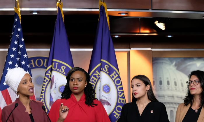 Representatives Ilhan Omar (D-MN) speaks as, Ayanna Pressley (D-MA), Alexandria Ocasio-Cortez (D-NY), and Rashida Tlaib (D-MI) listen during a press conference at the U.S. Capitol in Washington on July 15, 2019. (Alex Wroblewski/Getty Images)