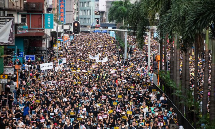 Protesters march against a controversial extradition bill in Hong Kong on July 21, 2019. (ANTHONY WALLACE/AFP/Getty Images)