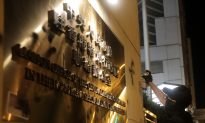In Direct Challenge, Hong Kong Protesters Deface Beijing's Representative Office