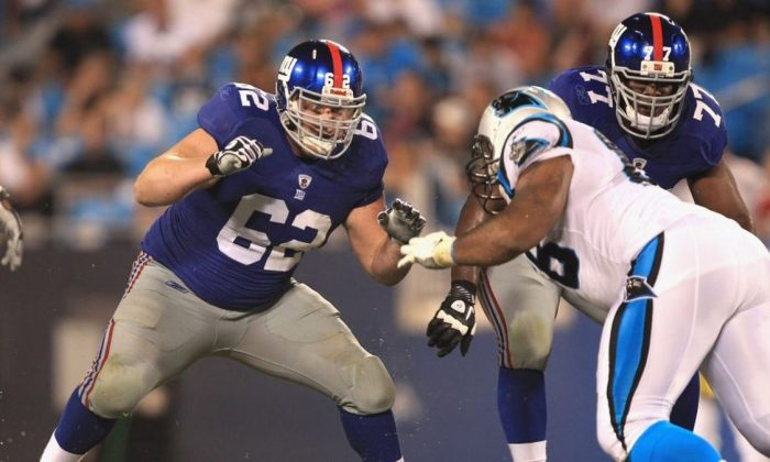 Mitch Petrus #62 of the New York Giants against the Carolina Panthers during their preseason game at Bank of America Stadium on Aug. 13, 2011, in Charlotte, North Carolina. (Photo by Streeter Lecka/Getty Images)