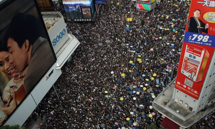 Protesters march to call for democratic reforms, in Hong Kong, on July 21, 2019. (Tyrone Siu/Reuters)