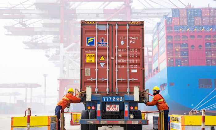 Workers prepare a container at the port in Qingdao, China's eastern Shandong province, on Jan. 14, 2019. (STR/AFP/Getty Images)