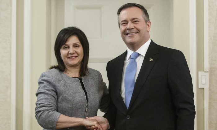 Alberta Premier Jason Kenney shakes hands with Education Minister Adriana LaGrange after she was sworn into office in Edmonton on April 30, 2019. (The Canadian Press/Jason Franson)